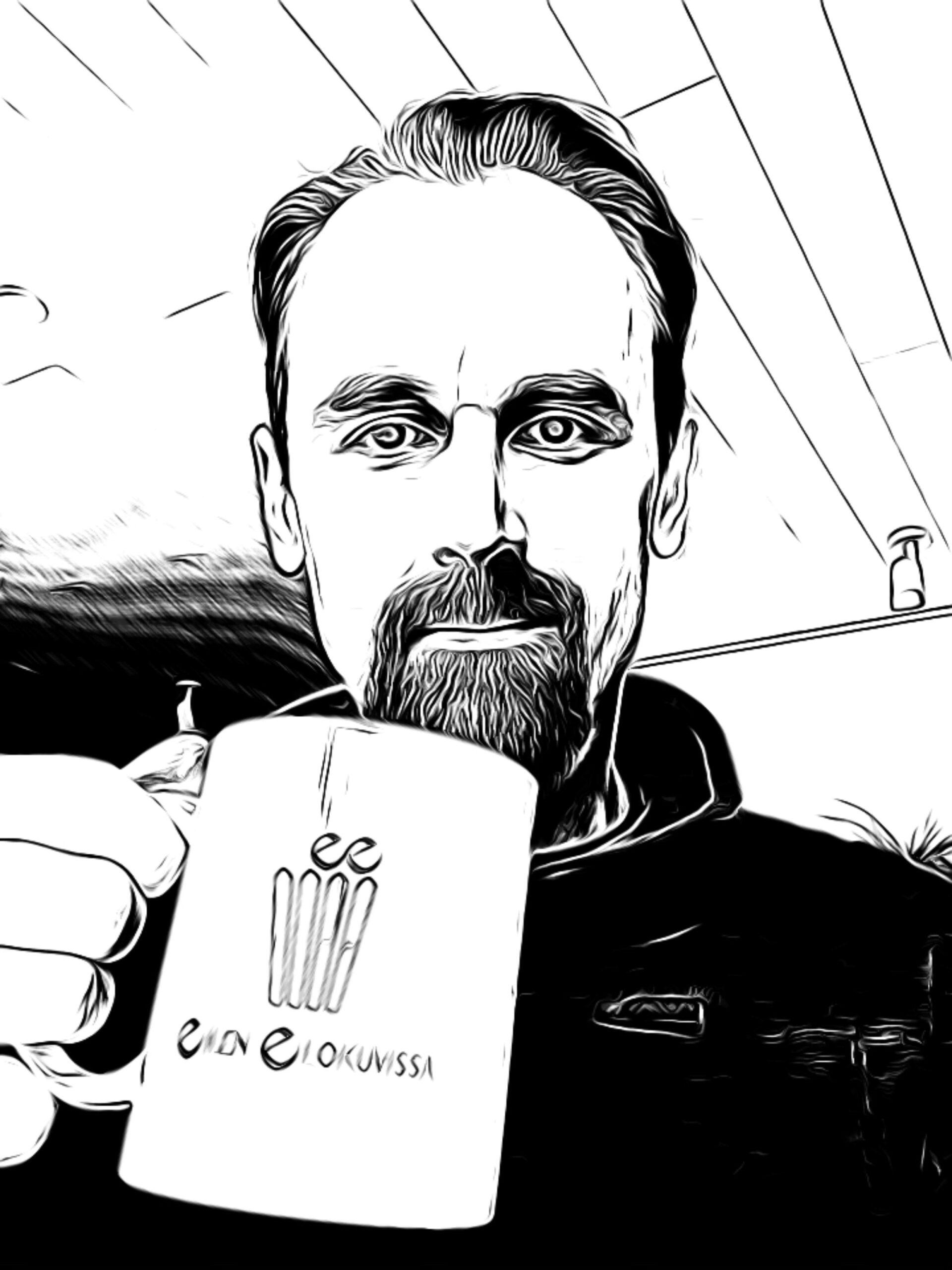 Blogin ylläpitäjä Henrik kahvikuppi kädessään.
